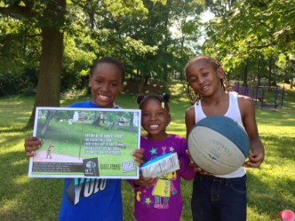 Photo of kids at Salem Heights park holding the Elect Esrati poster